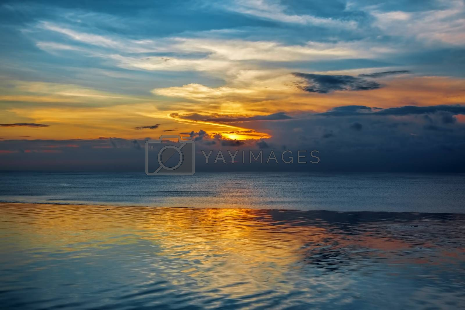 Balinese sunset with blue water and colorful skies