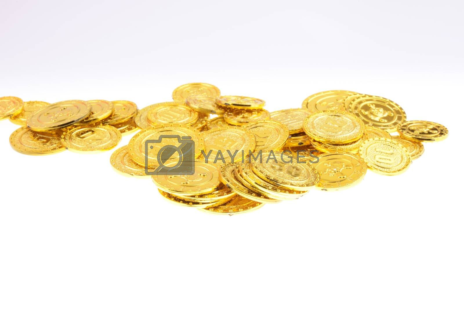 Pile of gold coins on a white background
