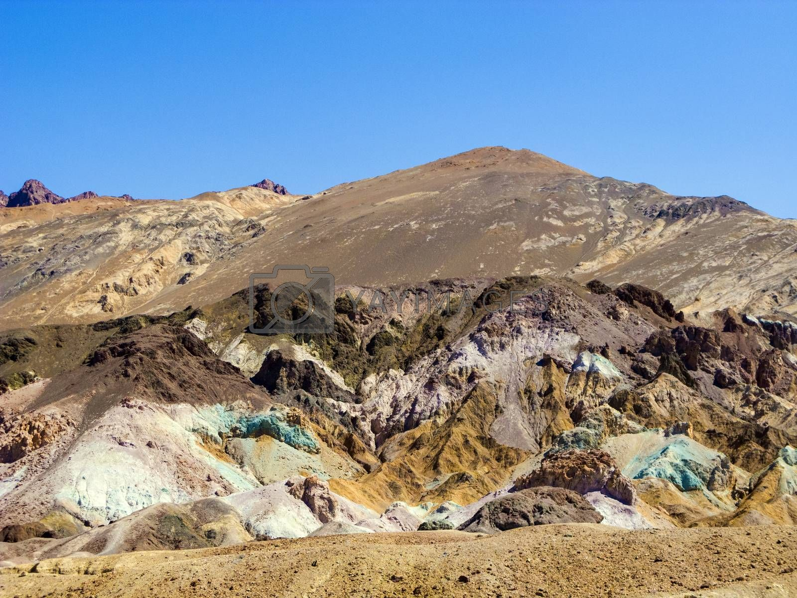 he variegated slopes of Artists Palette in Death Valley, California. Various mineral pigments have colored the volcanic deposits found here.
