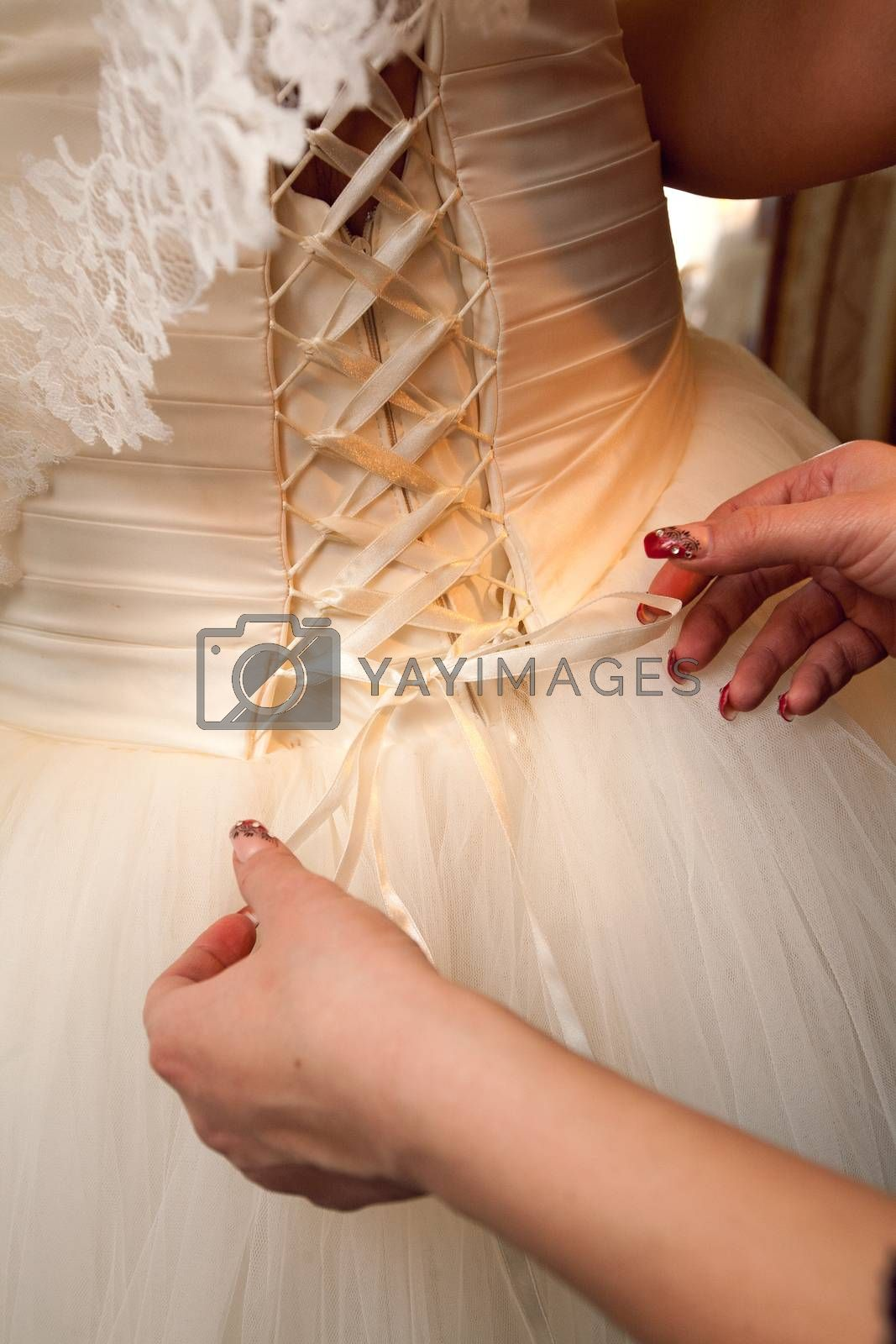 back of a wedding dress with artificial flowers