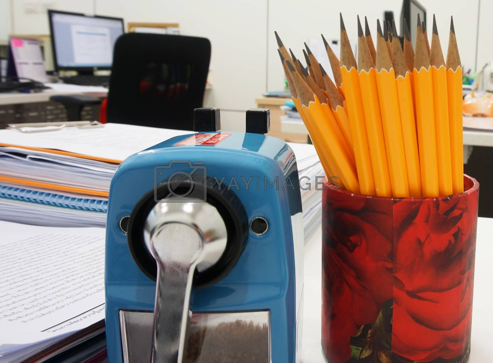 Office supplies on desk have document clip board ,document, pensil, sharpener etc.