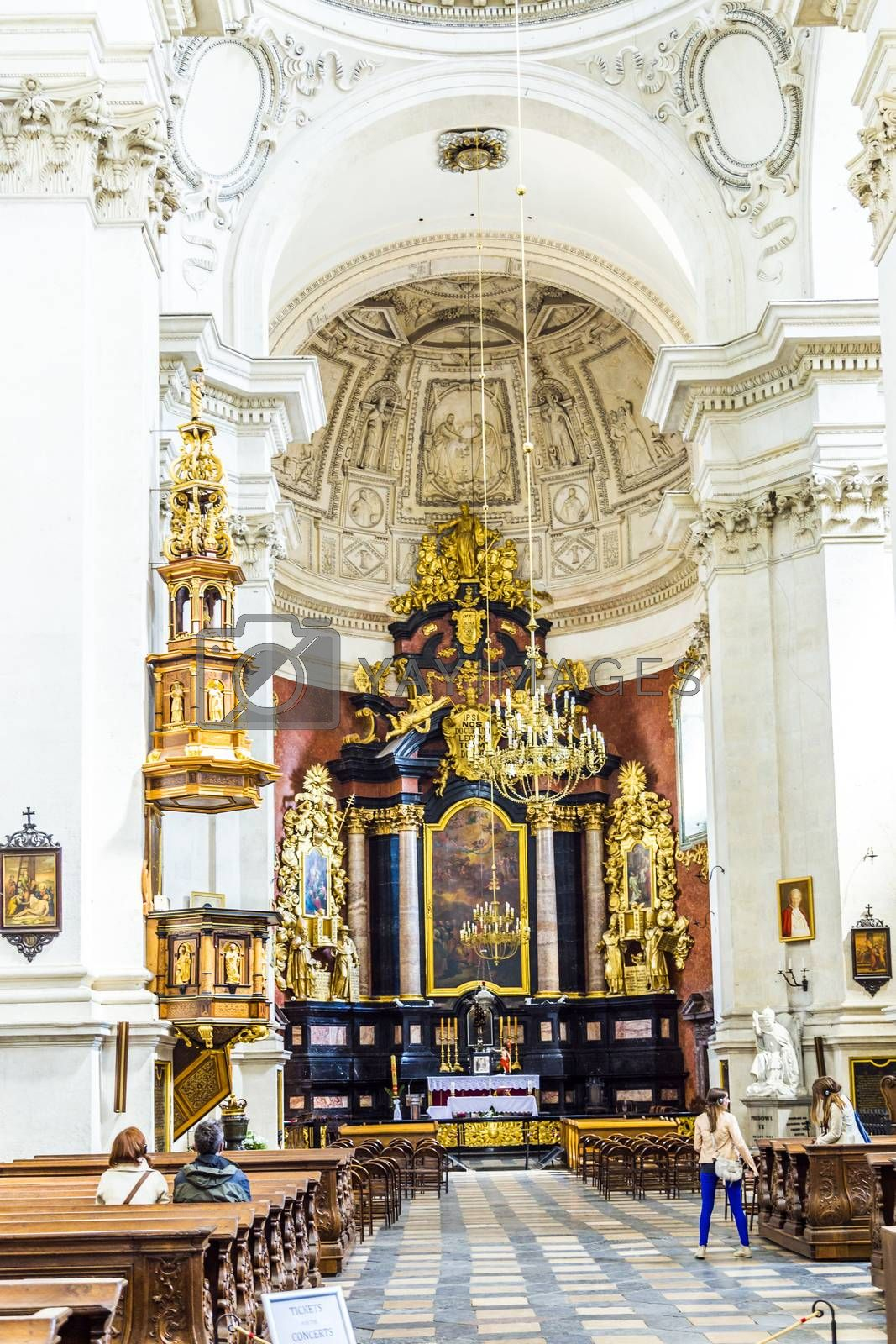 KRAKOW, POLAND - MAY 4, 2014: people visit Church of Saints Peter and Paul in Old Town district. It is biggest of historic Churches of Krakow in terms of seating capacity, was built between 1597-1619.