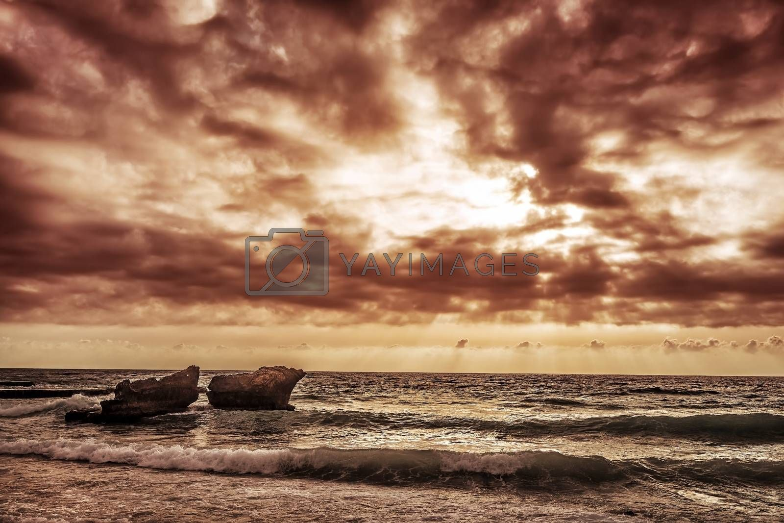 Grunge style photo of cliffs in Mediterranean sea in Lebanon, dark cloudy sky, overcast weather, summer storm concept