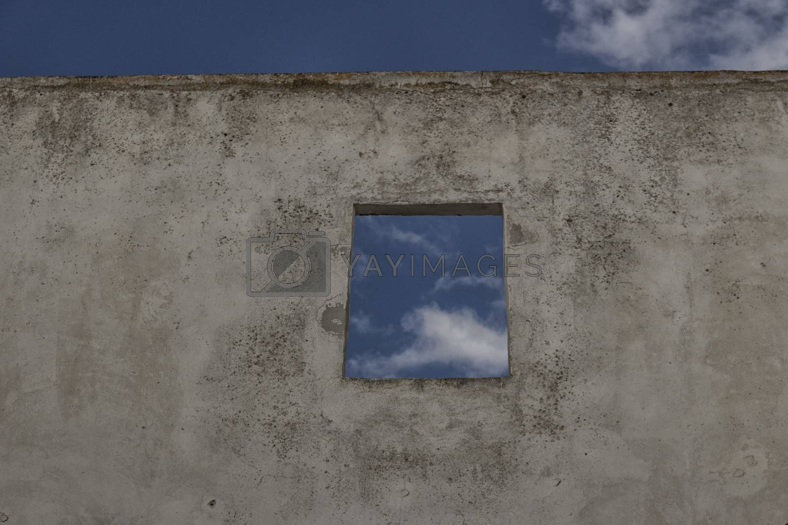 Square window on old ruined wall on the roof of Doxi Stracca Fontana Palace about 1760 A.D. in the old town of Gallipoli (Le)) in the southern Italy