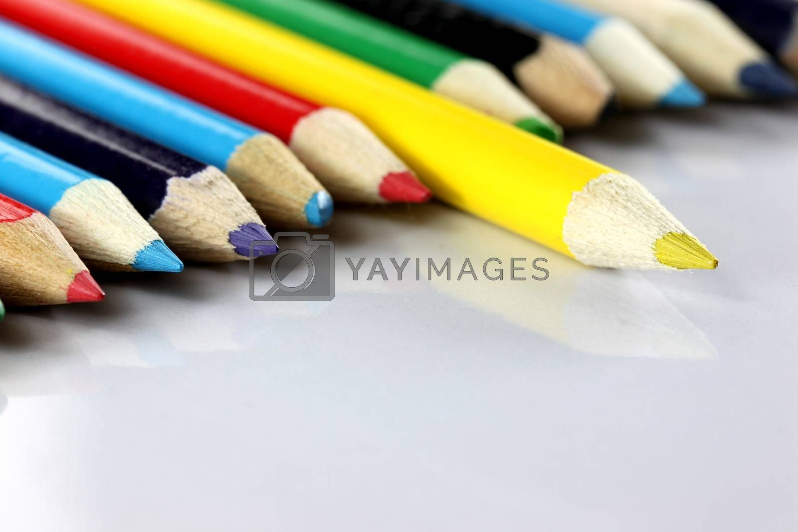 Several colored of crayon is arranged on white. by PiyaPhoto