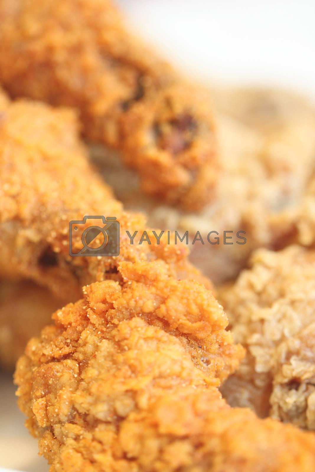 Fried chicken on a dish. by PiyaPhoto