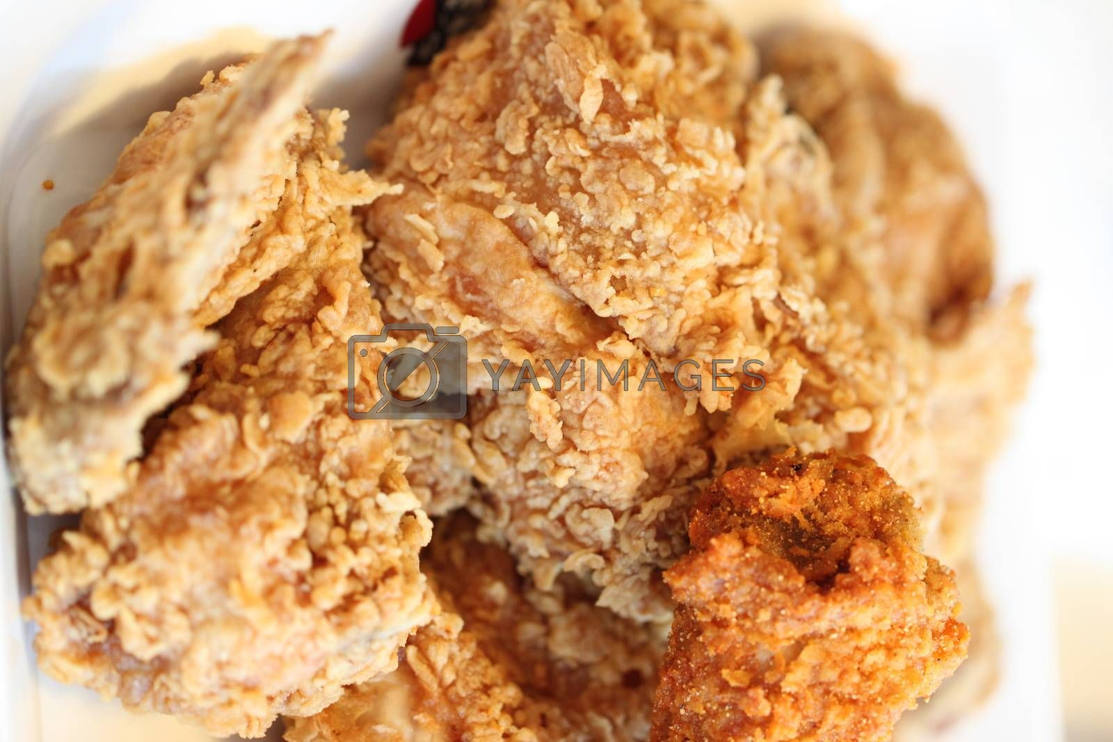 Fried chicken on a dish. by PiyaPhoto
