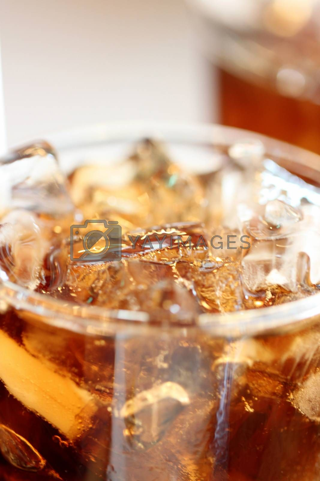 Ice cola drinks in glass. by PiyaPhoto