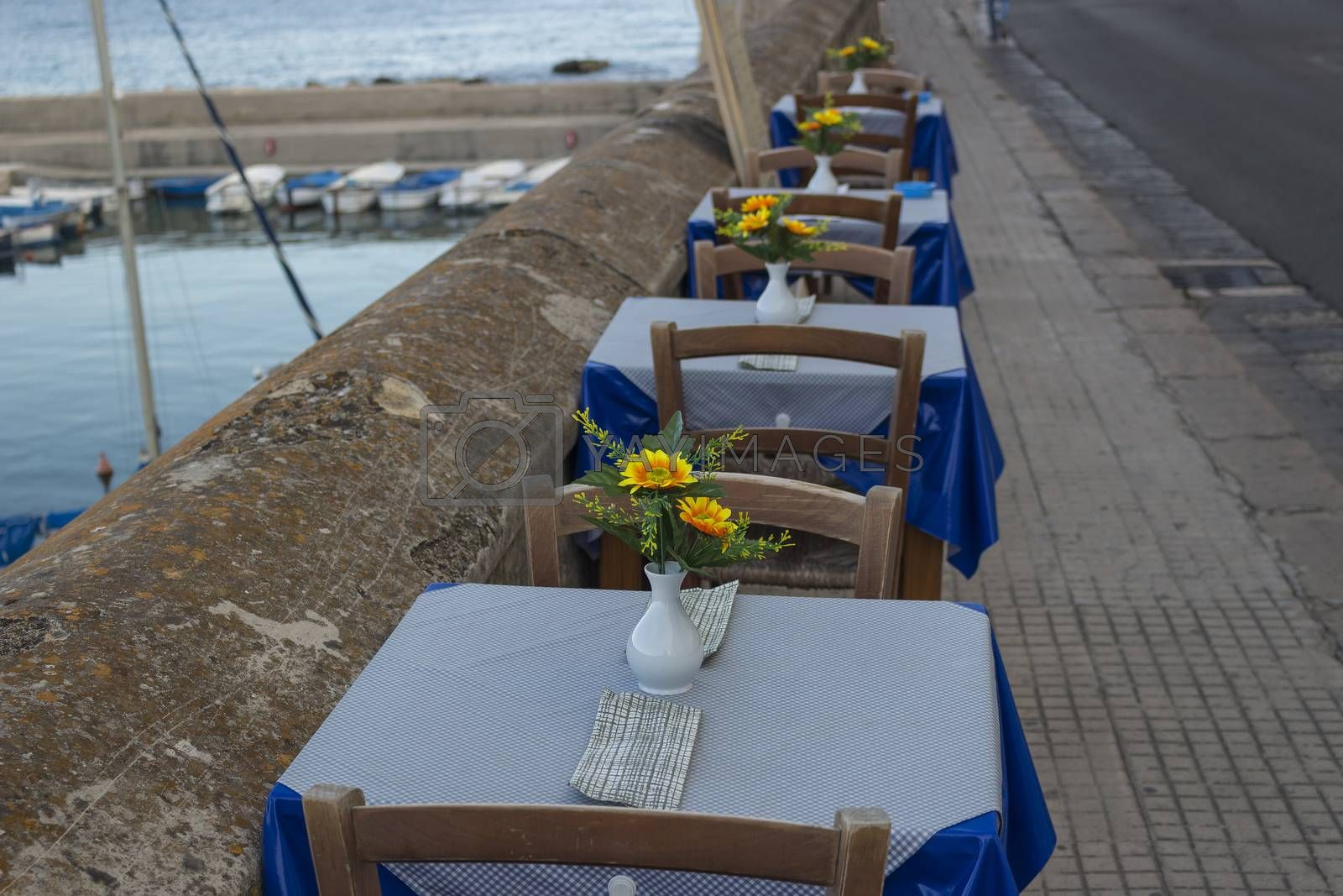 Restaurant on the sea bay between the Rivelino castle and the Church of Sain Mary of Canneto in the old town of Gallipoli (Le) in southern Italy