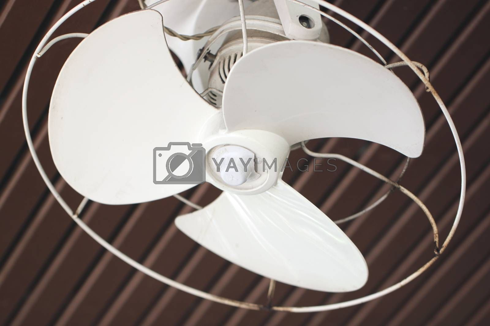 white fan Hanging from the ceiling.