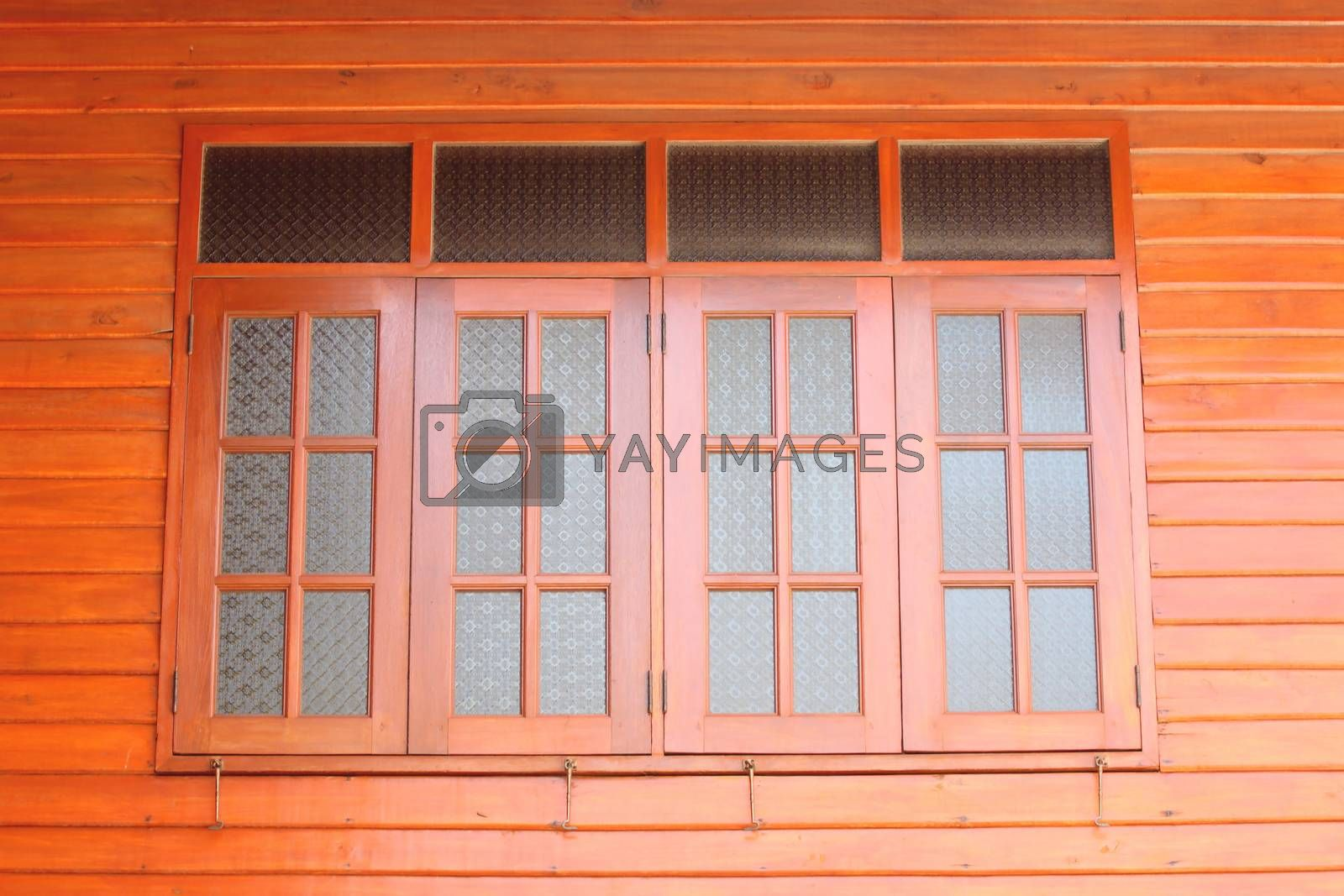 windows on brown wooden wall in house for background.