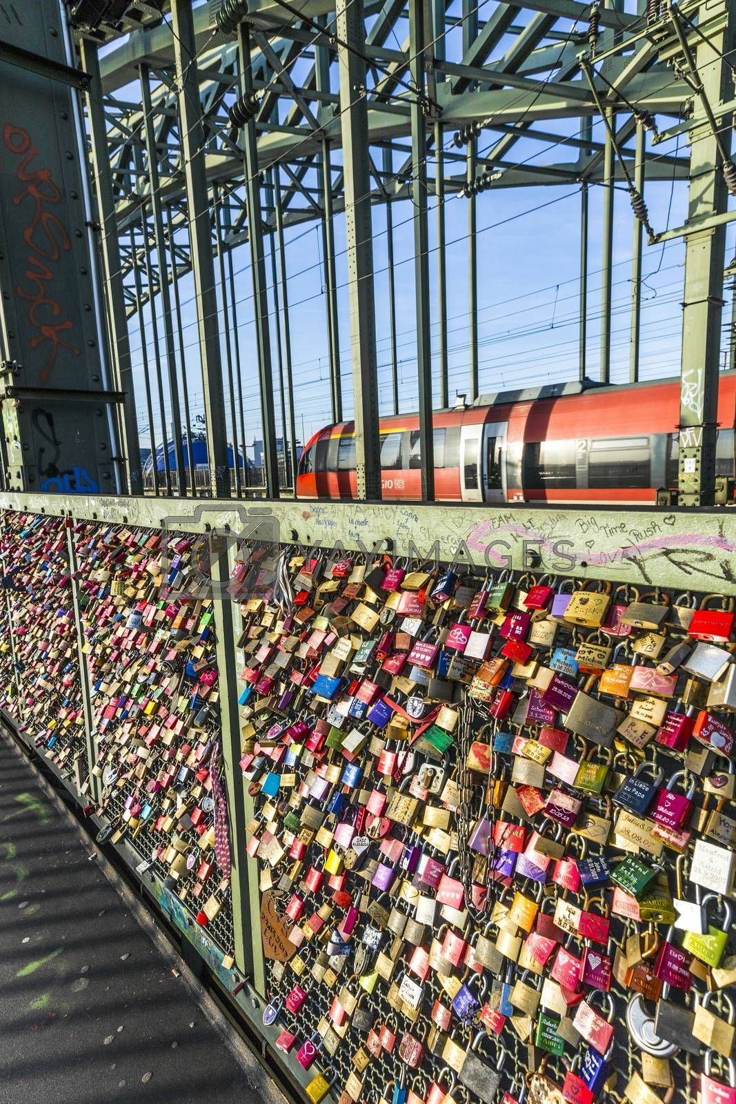 COLOGNE, GERMANY - DEC 3, 2013: lockers at the Hohenzollern bridge symbolize love for ever in Cologne, Germany. 40000 lockers of loving couples are on that heavily used railway bridge.