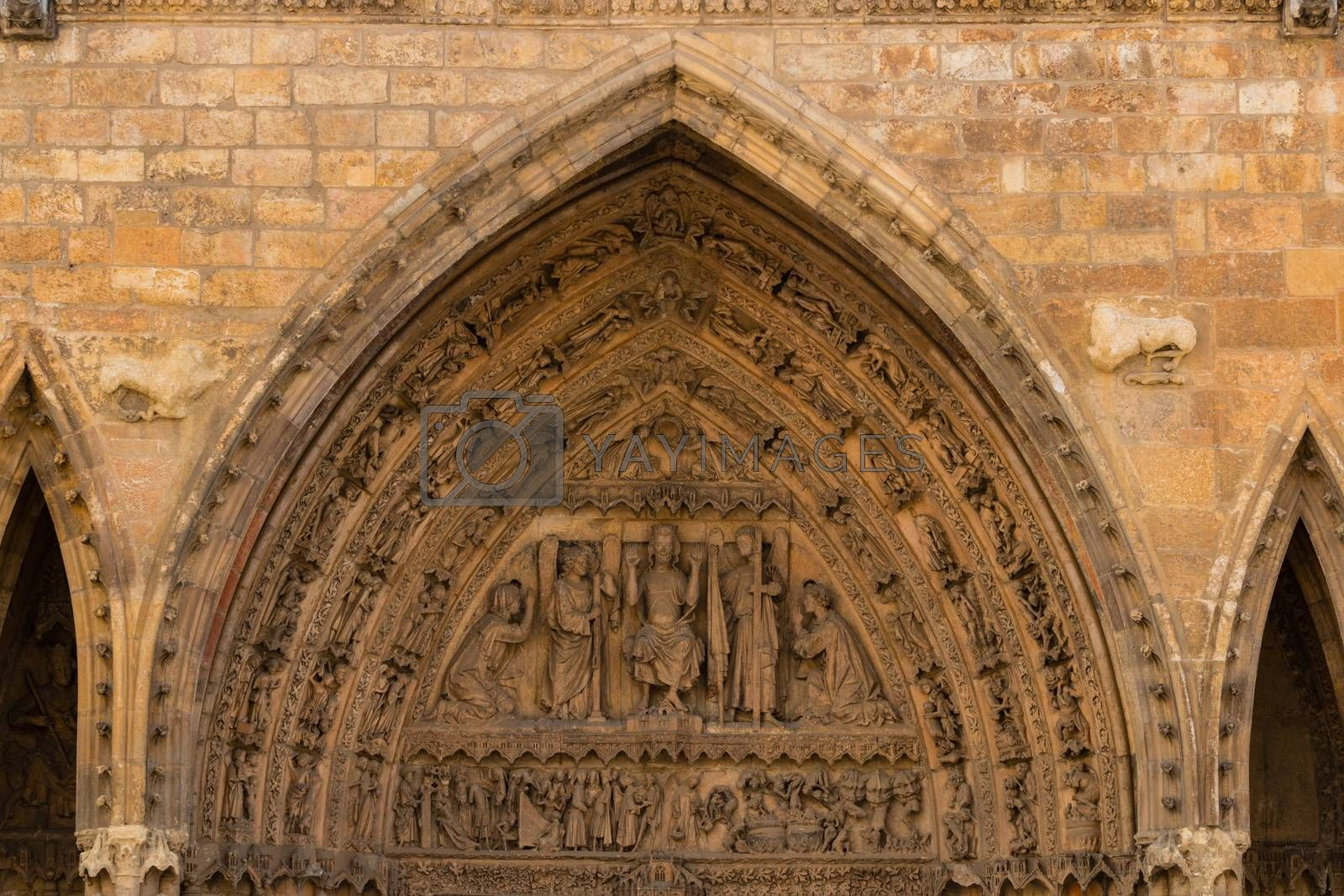 Tympanum and archivolts detail of the gothic main entrance door in the Cathedral of Leon , Spain
