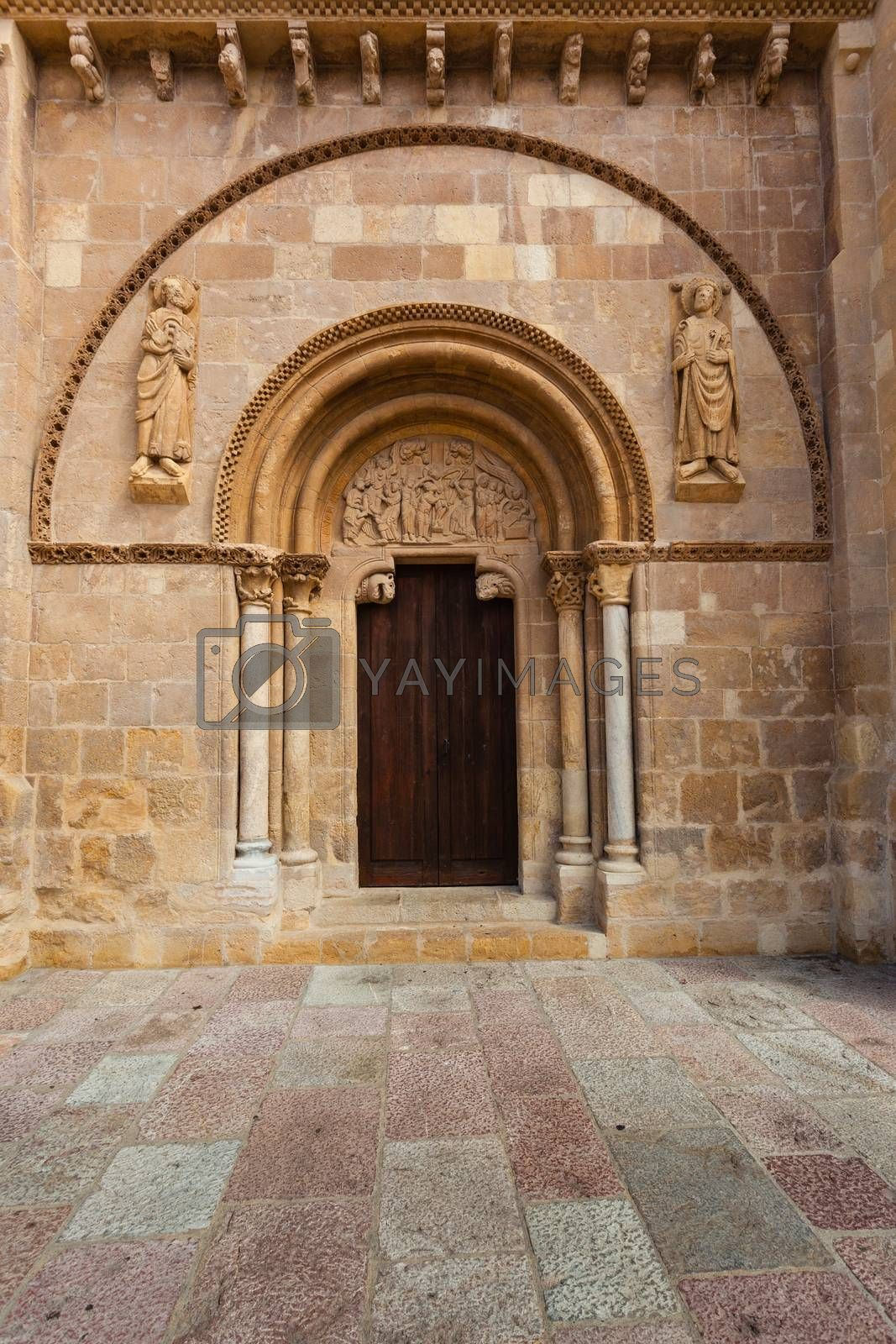 Romanesque style door with the carved tympanum called Puerta del Cordero in the Royal San Isidoro collegiate church from the X century i n Leon Spain