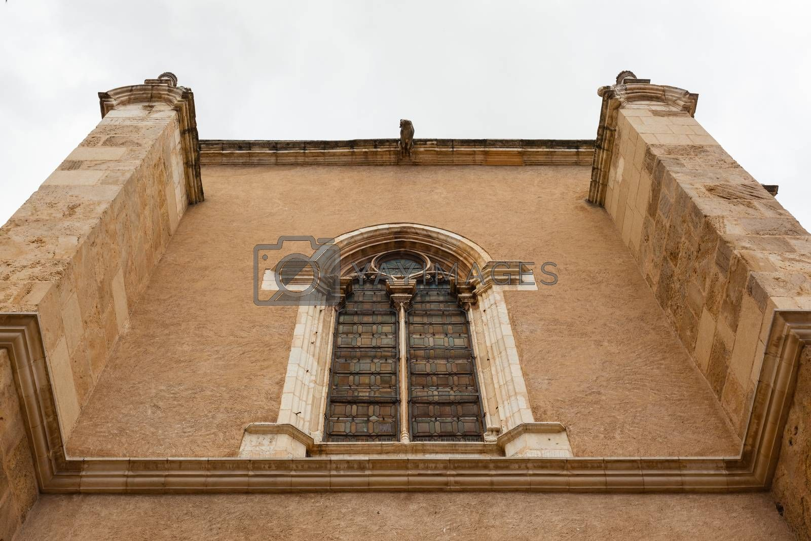 Elegant wall and stained glass window from the building attached  to the romanesque San Isidoro collegiate church in the province of Leon , Spain