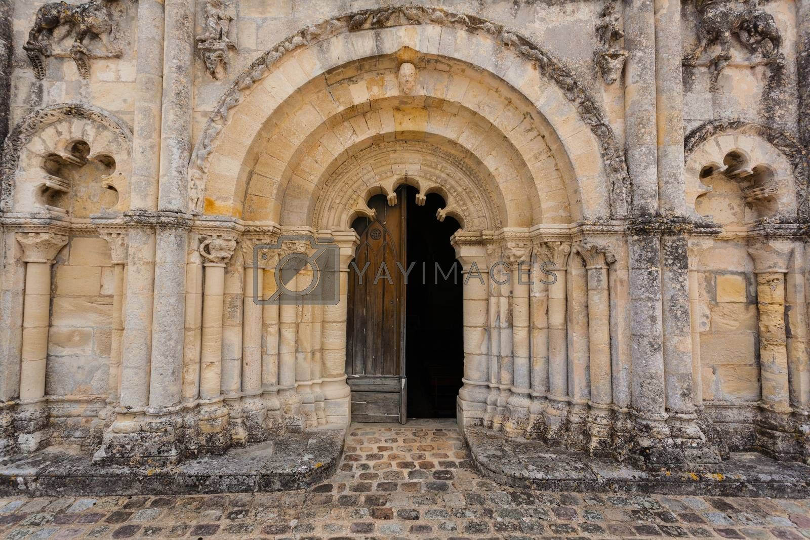 Full view of the main door of Petit Palais et Cornemp romanesque church, Gironde France