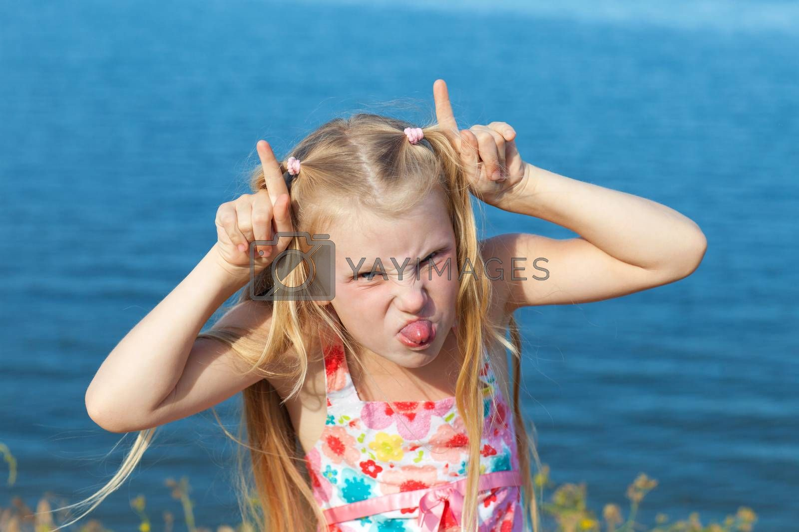 girl making face on seashore