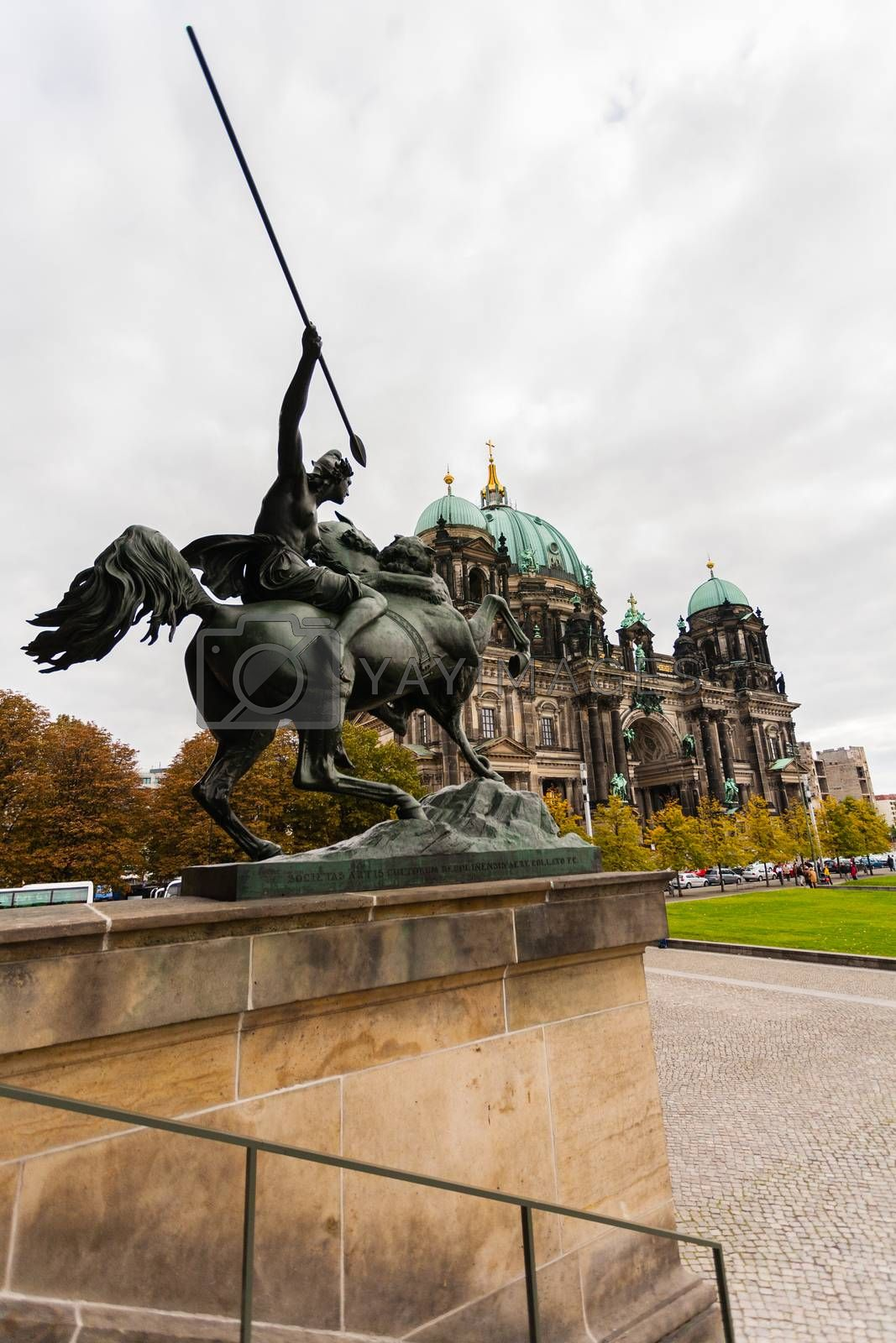 Od view of the Evangelical cathedral also known as  Supreme Parish and Collegiate Church with  horseman in the forefront in Berlin ,Germany