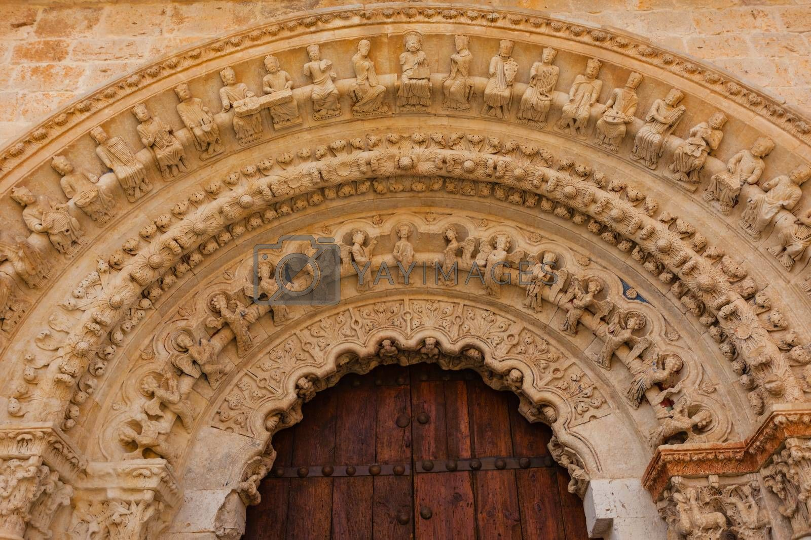 closeup view of romanesque archivolts and voussoir detail from the collegiate church of the town of Toro in Zamora Spain