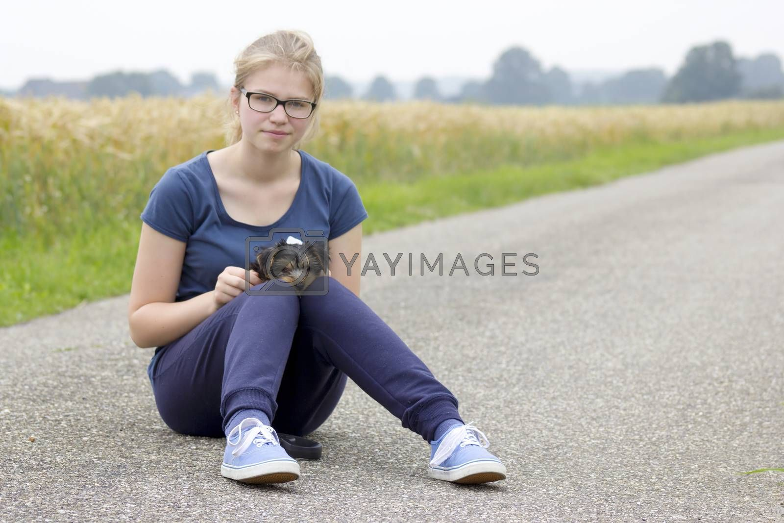 Royalty free image of young girl and her dog by miradrozdowski
