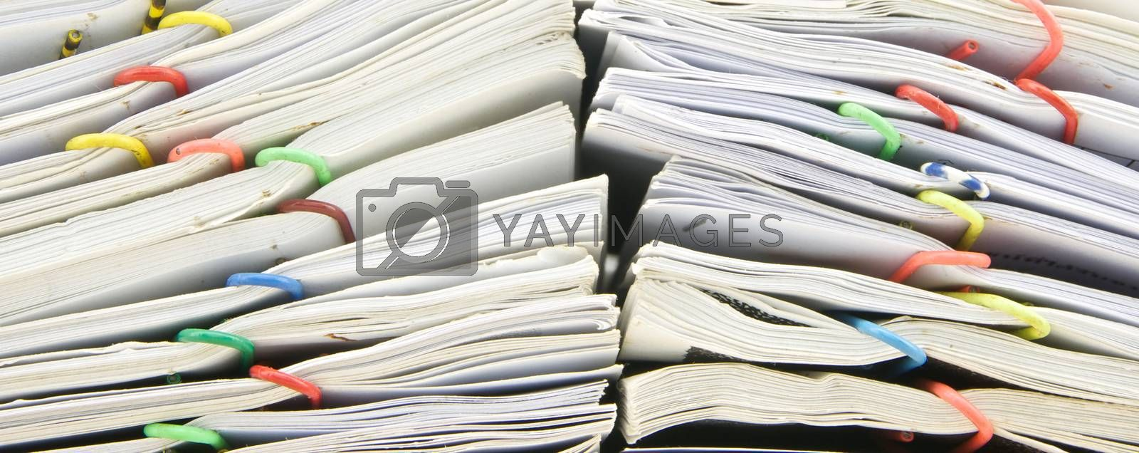 Close up stack of sales and receipt place on wood background.