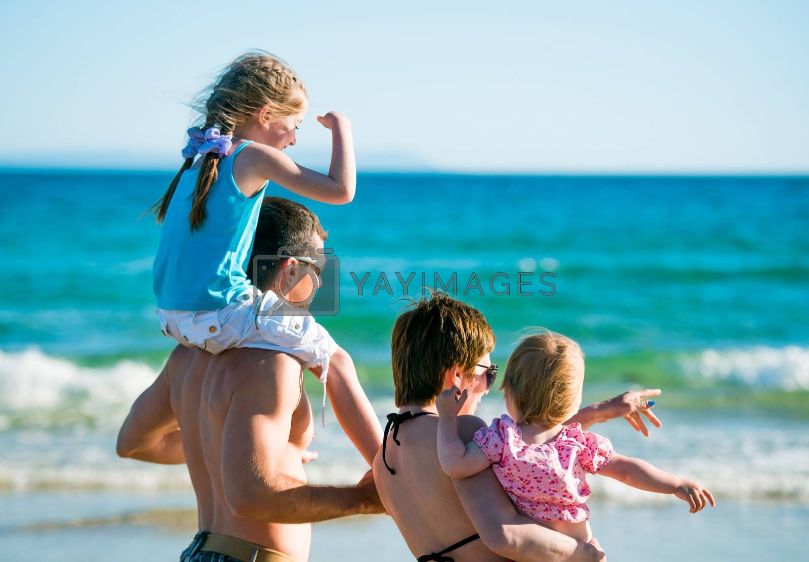 family with child and baby on sea vacation