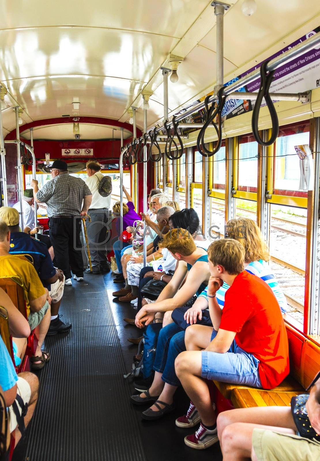 NEW ORLEANS - JULY 15, 2013: people travel with the famous old Street car St. Charles line in New Orleans, USA.  It is the oldest continually operating street car line in the world.