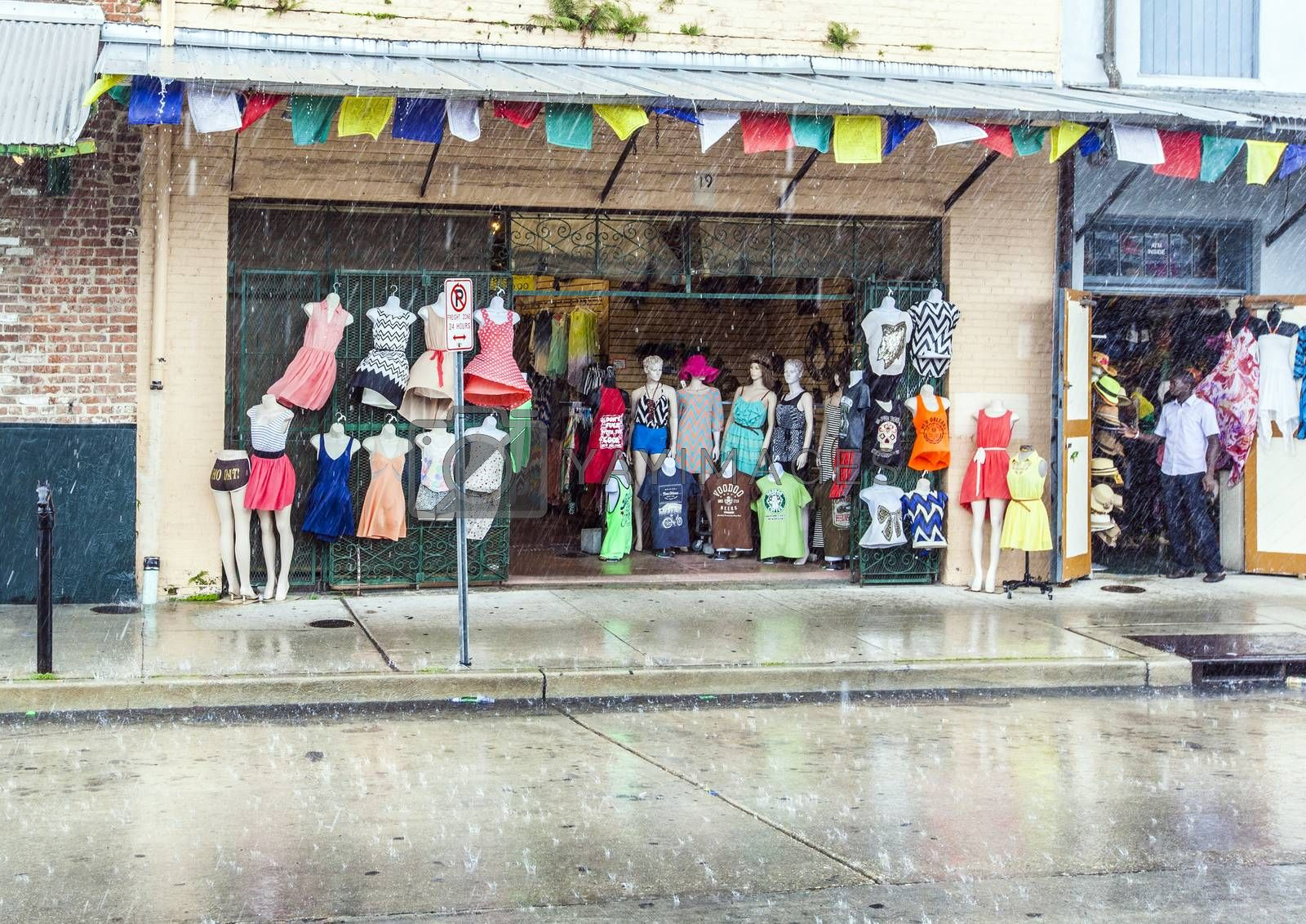NEW ORLEANS,  USA - JULY 15, 2013: rain at the French Market on Decatur Street in New Orleans, USA. It is a popular tourist attraction in the New Orleans French Quarter district.