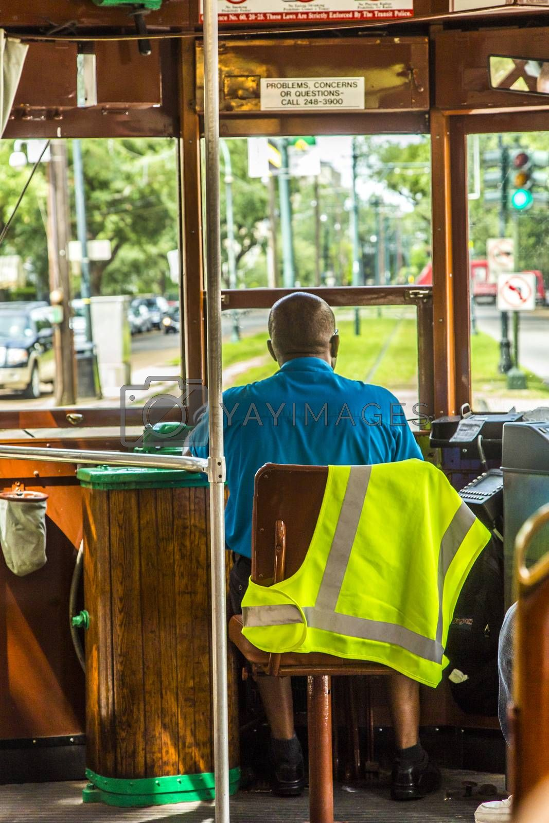 NEW ORLEANS - JULY 16, 2013:  conductor in the famous old Street car St. Charles line in New Orleans, USA. It is the oldest continually operating street car line in the world.