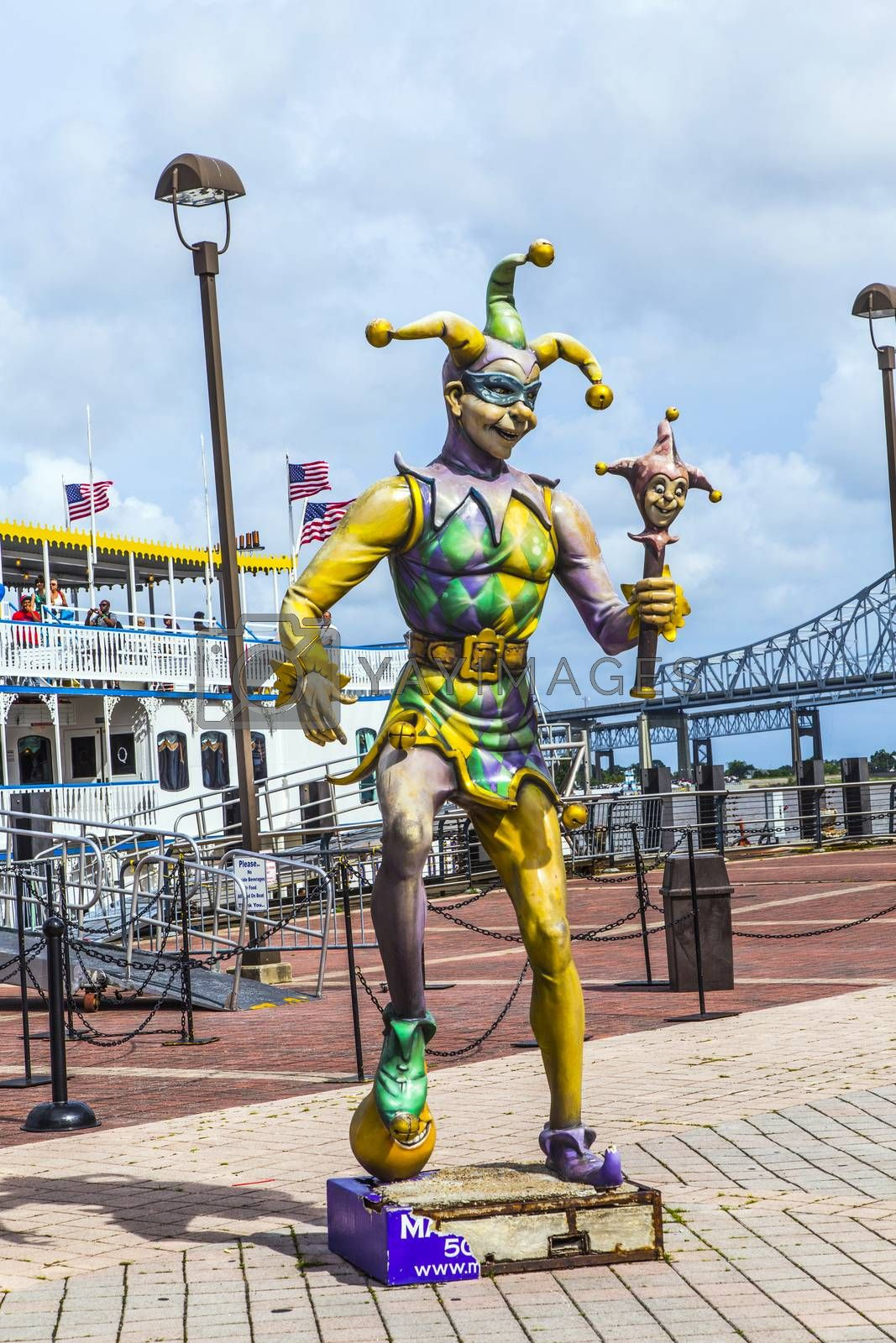 NEW ORLEANS - JULY 16, 2013: people at the creole Queen steam boat in New Orleans, USA. The Jester, symbol for Mardy Gras, stands in front.
