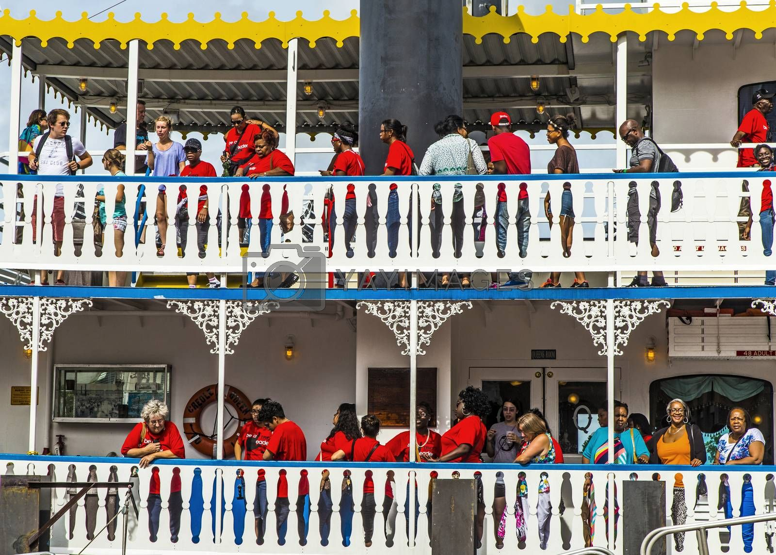 NEW ORLEANS - JULY 16, 2013: people at the creole Queen steam boat in New Orleans, USA. Constructed in Moss Point, Mississippi, the Creole Queen took her maiden voyage on October 1, 1983.