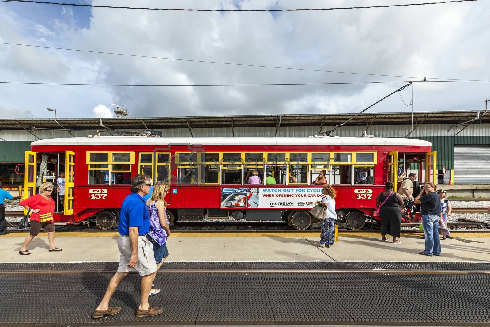 NEW ORLEANS, USA - JULY 16, 2013: people enter  the riverfront  Streetcar Line in New Orleans, USA. Revamped after Hurricane Katrina in 2005, the New Orleans Streetcar line began electric operation in 1893.
