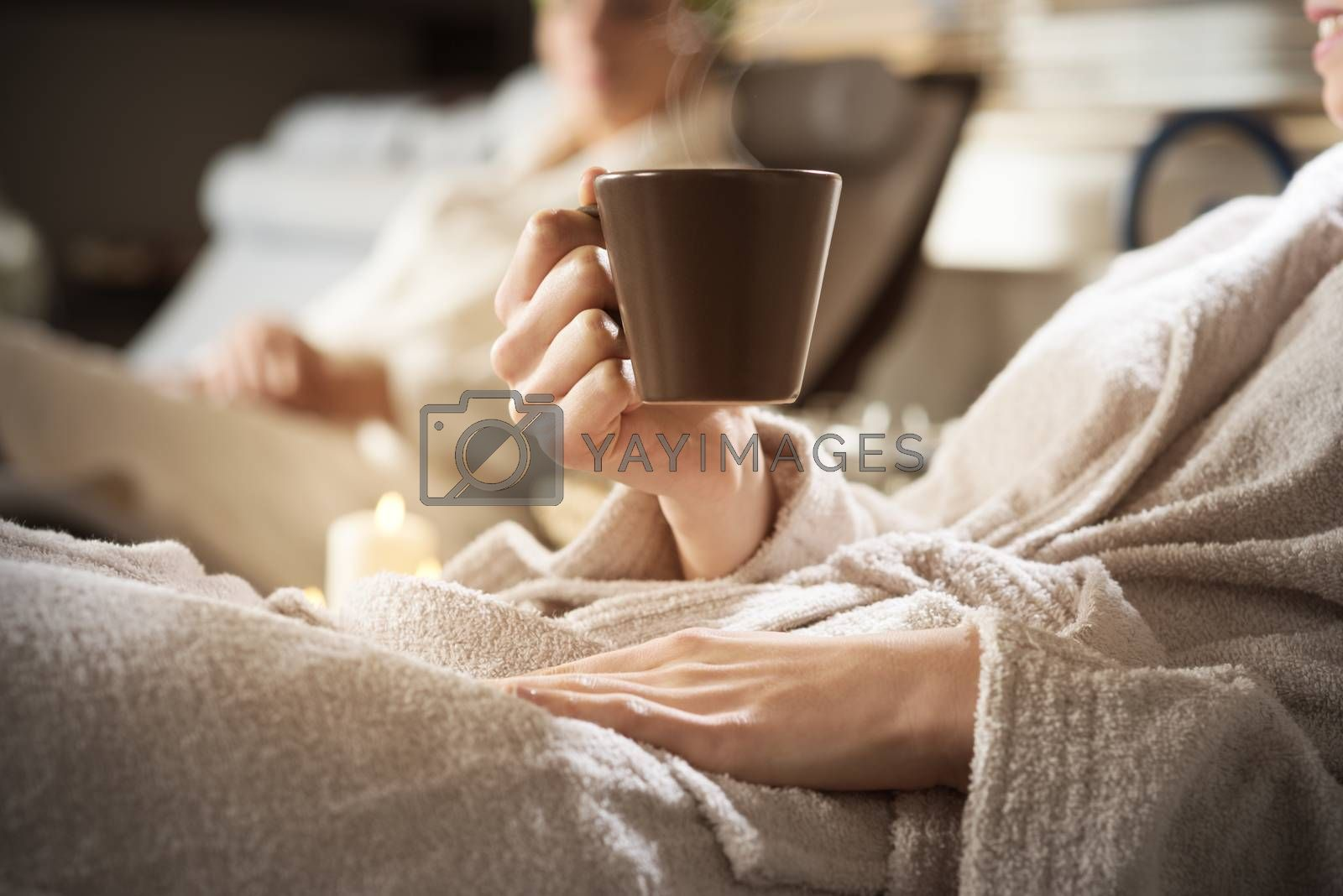 Beautiful women enjoying spa treatments, cup close up.
