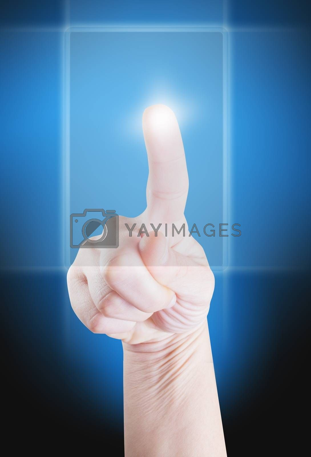 Picture of a finger pointing on a transparent device