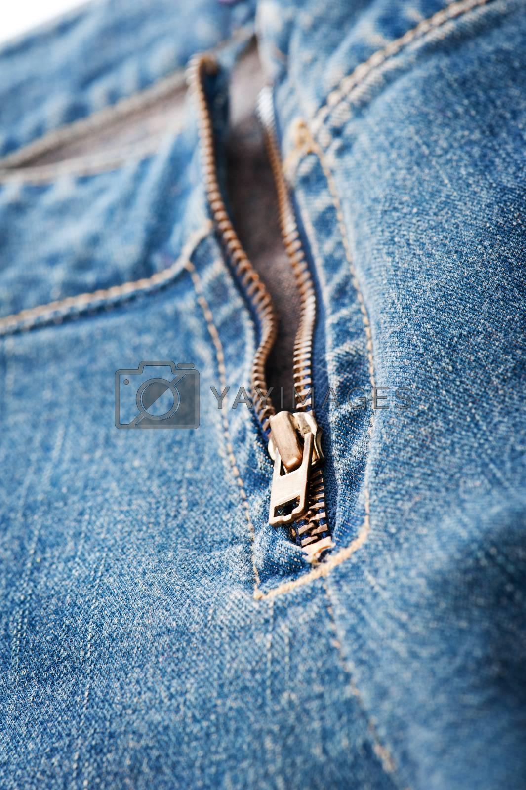 Closeup of blue denim jeans zipper