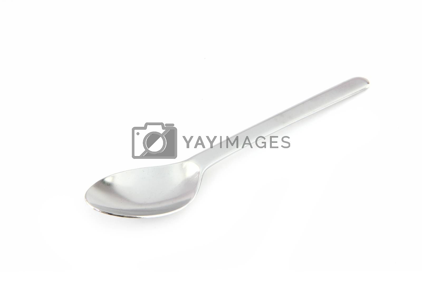 Stainless steel spoon on white background.
