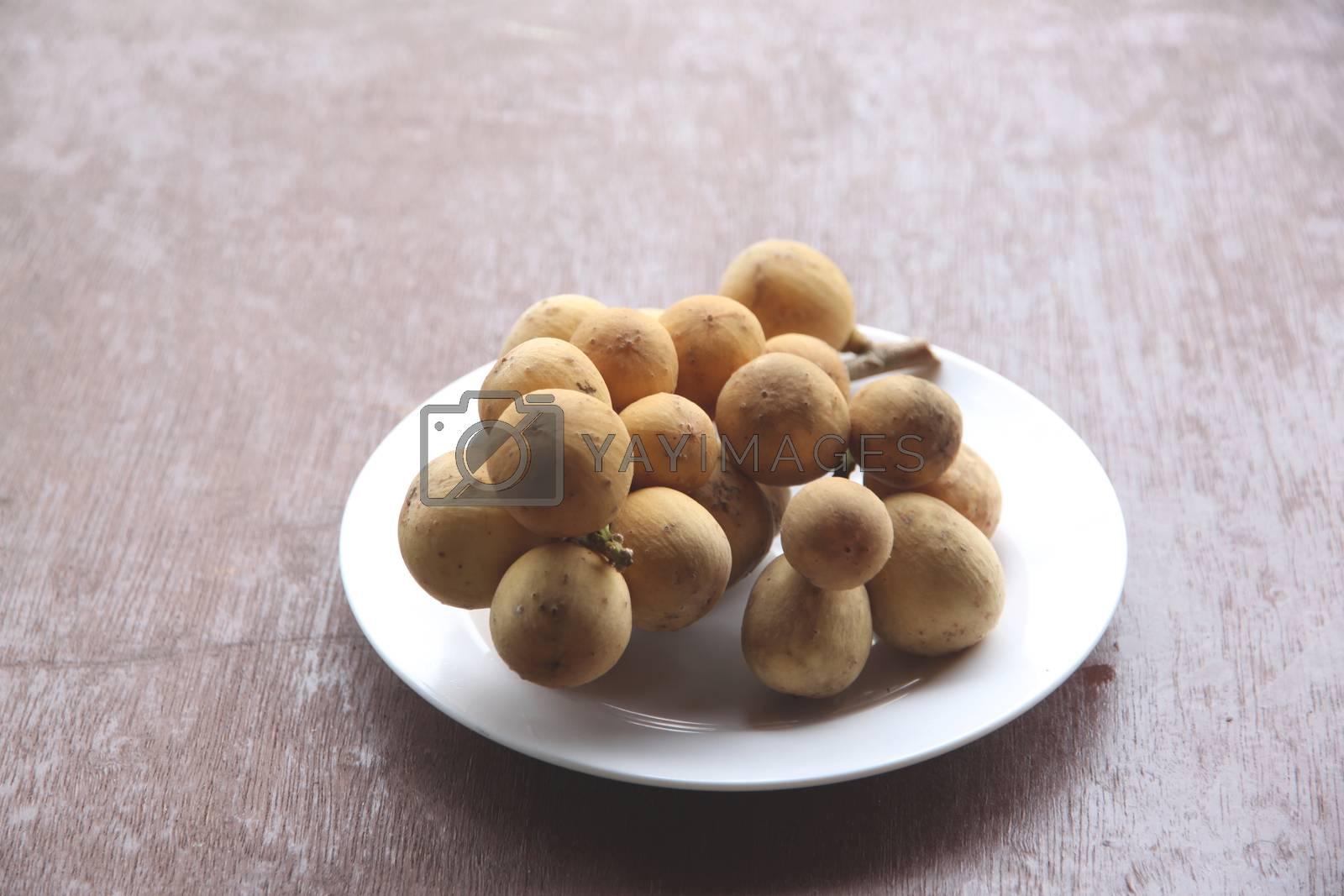 Fresh wollongong fruit in dish. by PiyaPhoto