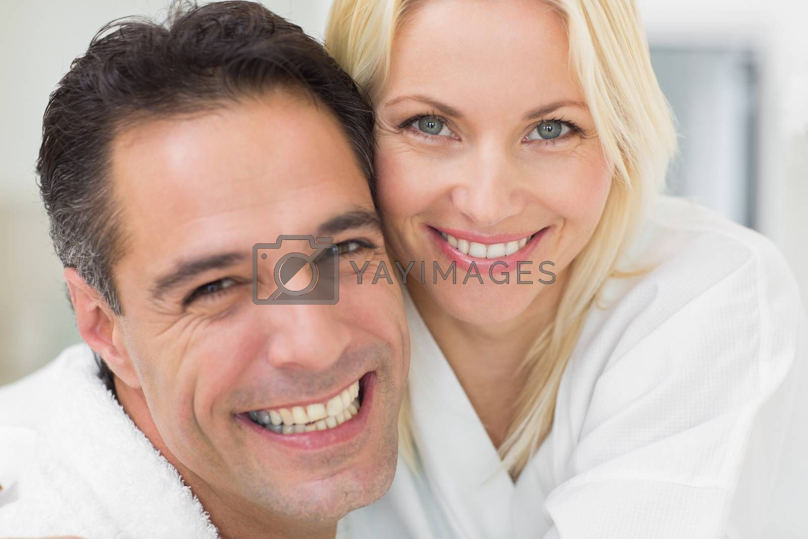Closeup portrait of a cheerful woman and man in the kitchen at home