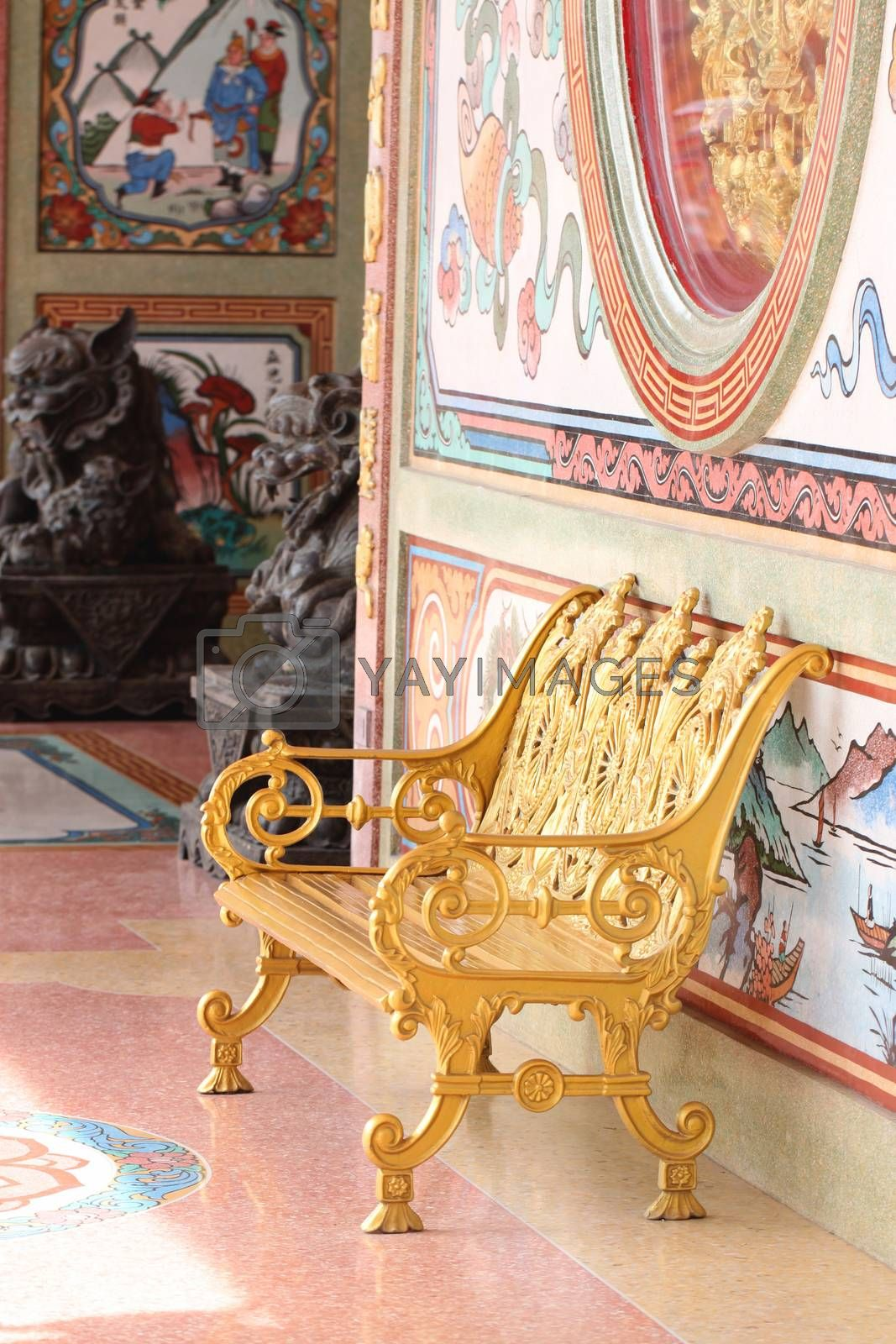 gold chair in Chinese temple. by PiyaPhoto