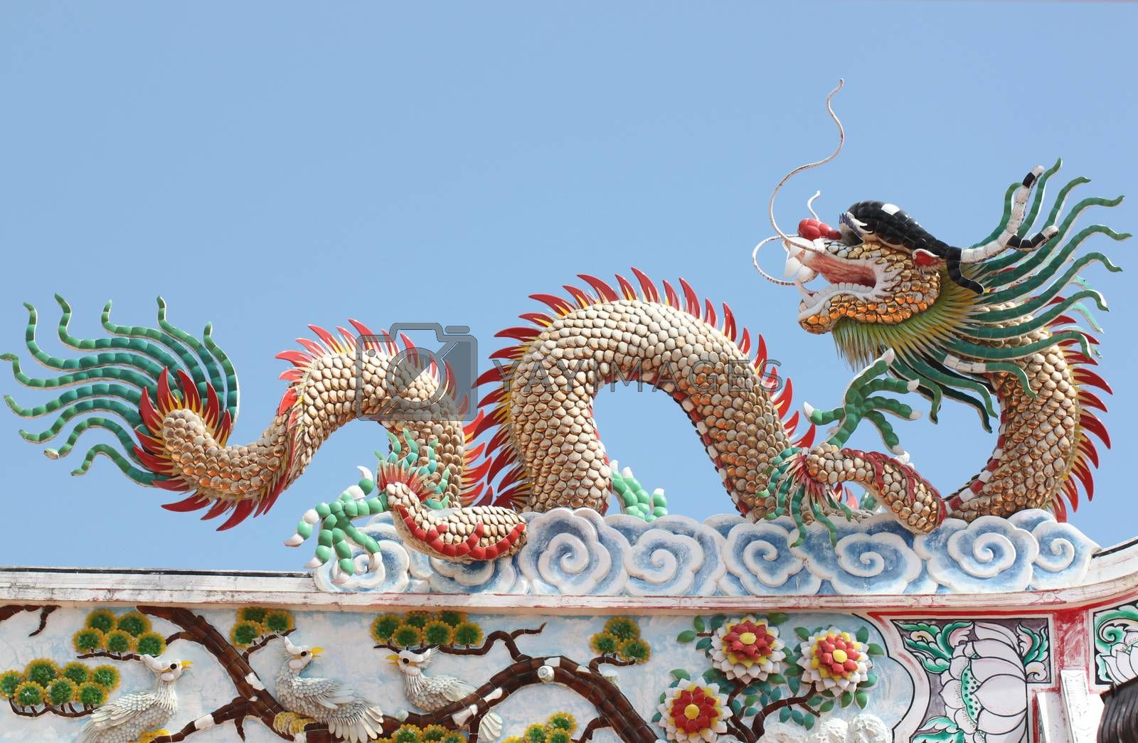 Dragon sculpture in Chinese temple. by PiyaPhoto