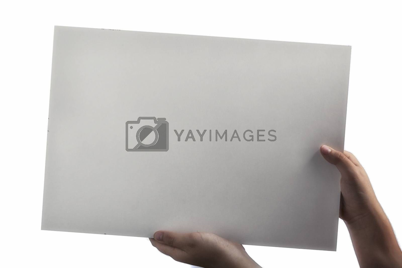 White Plastic laminate sign held up by hands by paocasa