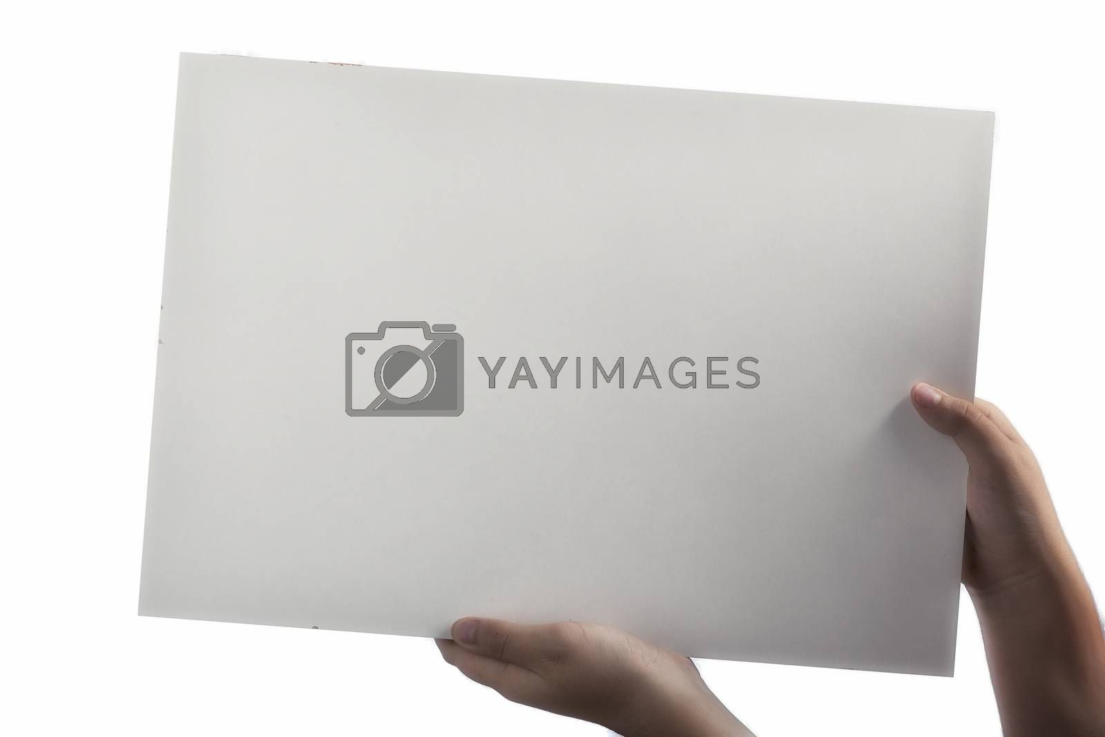 Royalty free image of White Plastic laminate sign held up by hands by paocasa