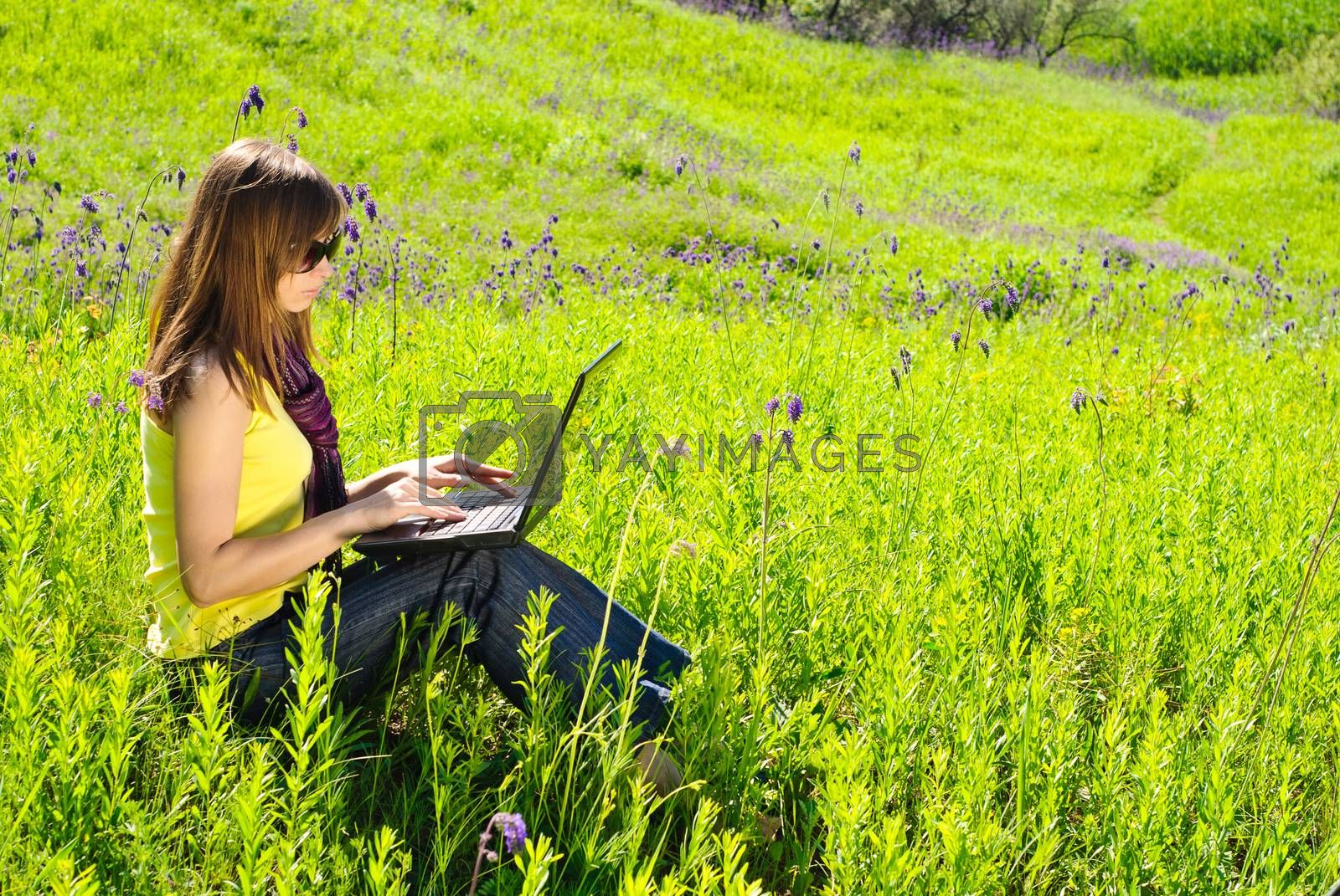 Royalty free image of Woman with laptop by olegator1977