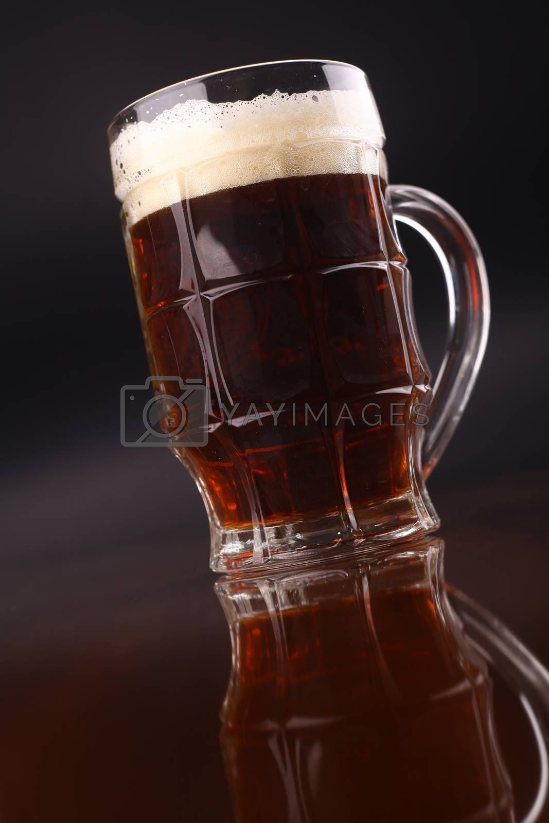 Royalty free image of Glass of beer by hiddenhallow
