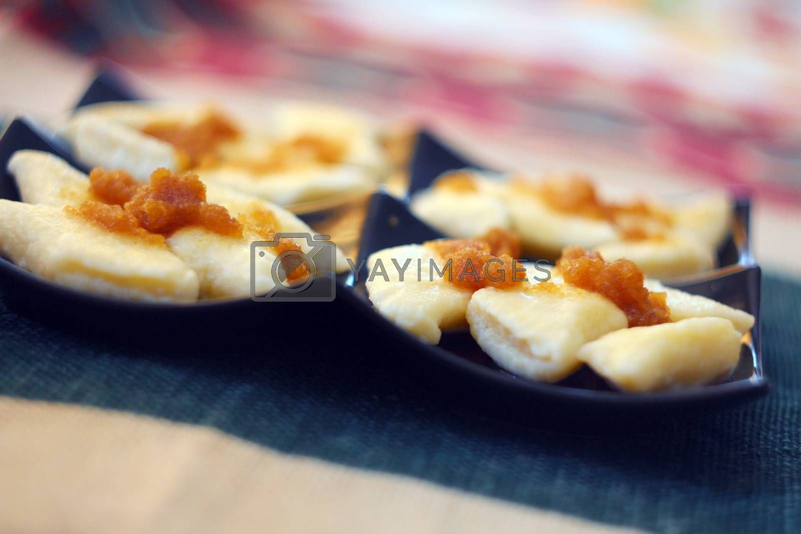 Royalty free image of Cooked traditional lazy noodles with crumbs on black plate by sanzios
