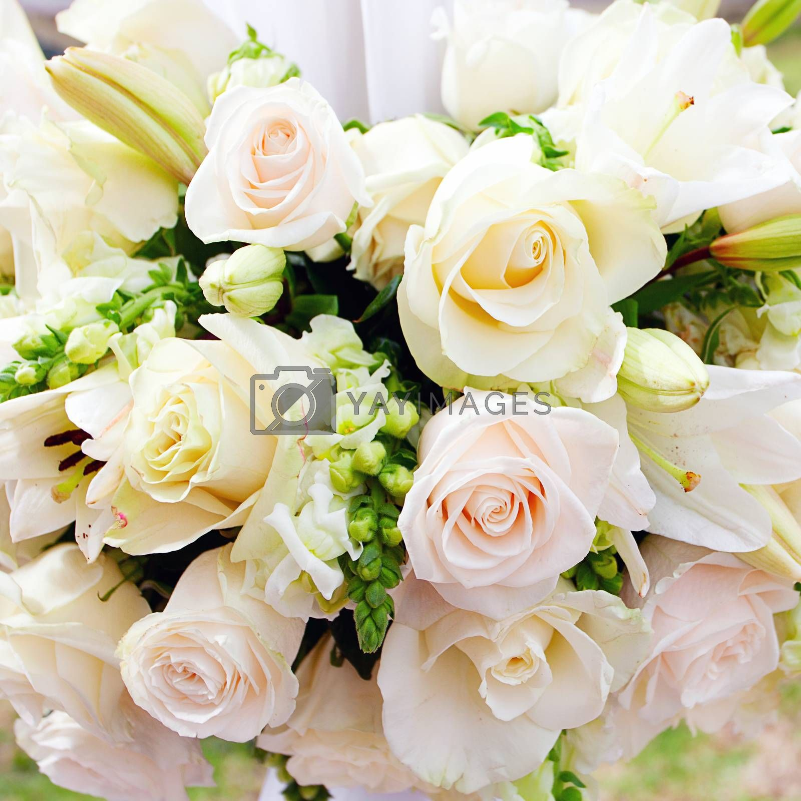 wedding marquee with bouquets of roses