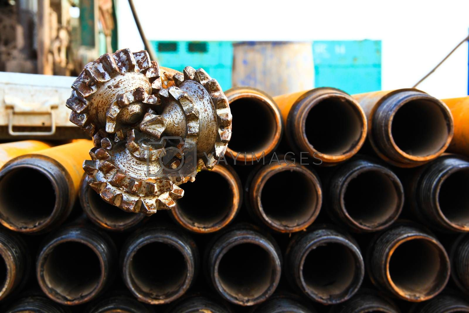 Royalty free image of oil rig drill bit with drilling pipe by nitimongkolchai
