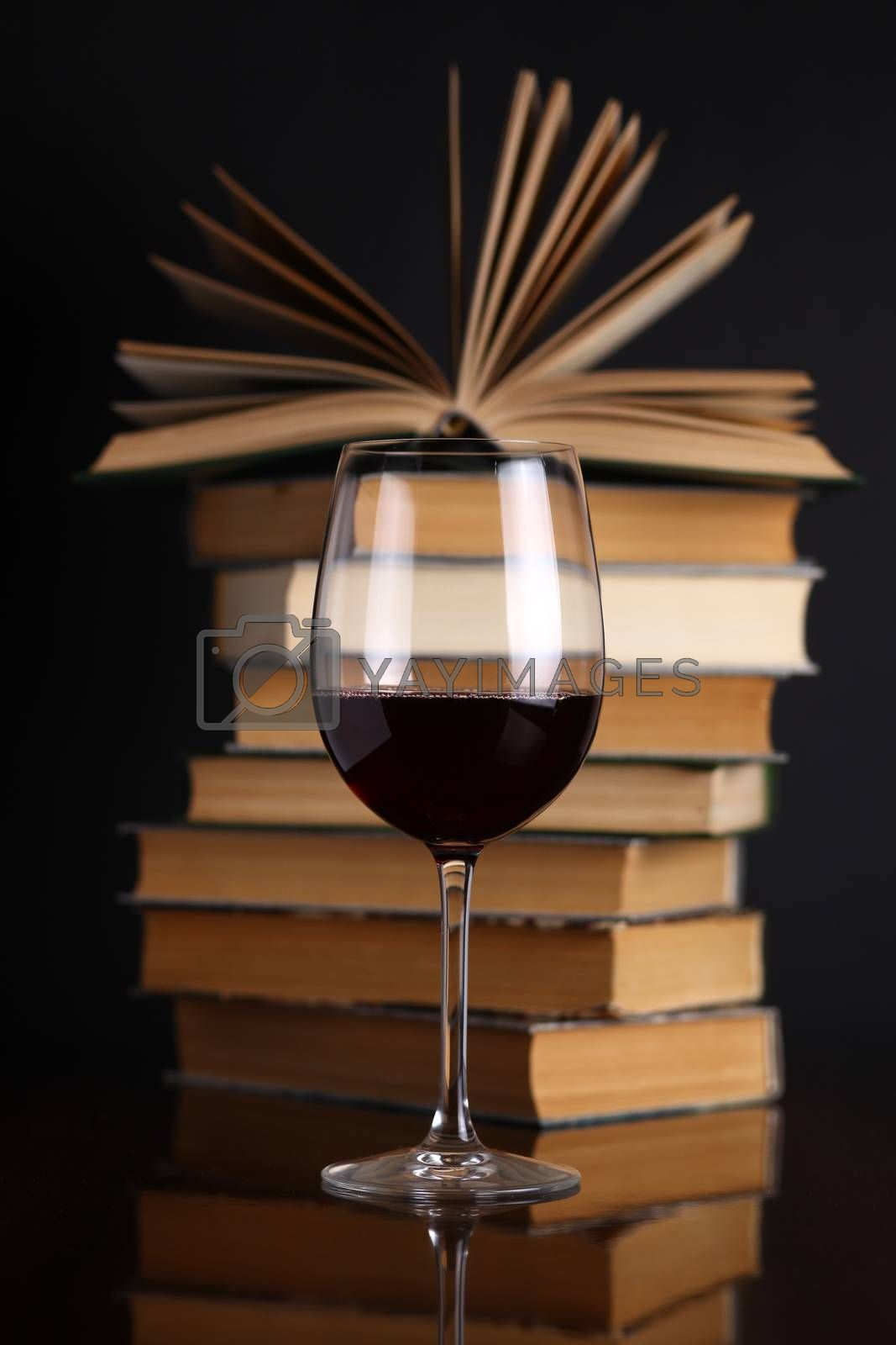 Royalty free image of Wine glass and books by hiddenhallow