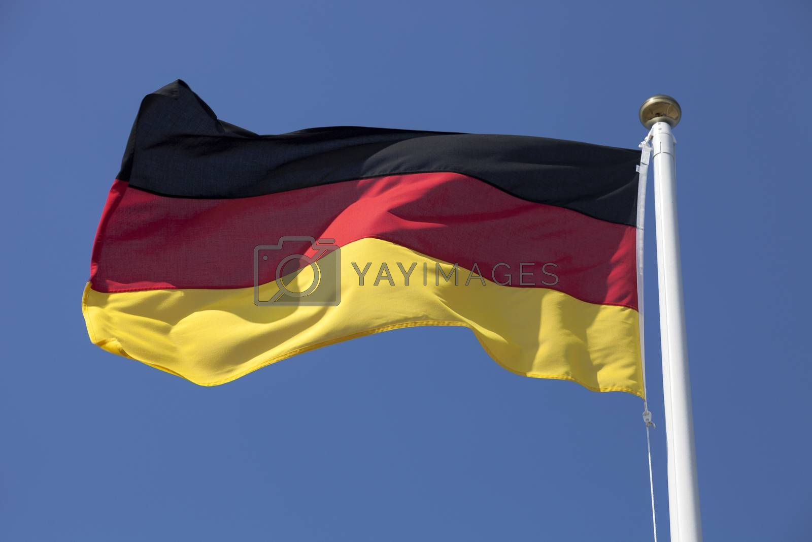 Royalty free image of Germany flag on blue sky by ints