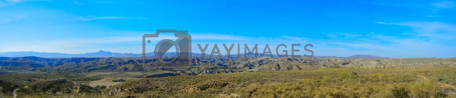 Panoramic mountain landscape view with blue sky